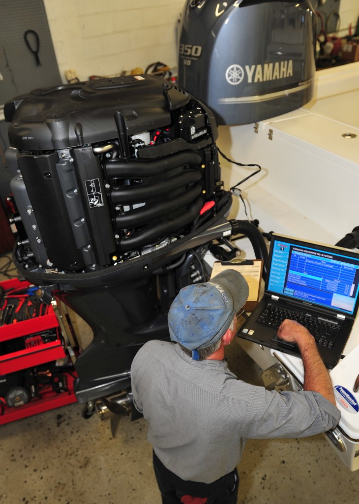 photo of a technician performing a Diagnostics test on a Yamaha 350 V8