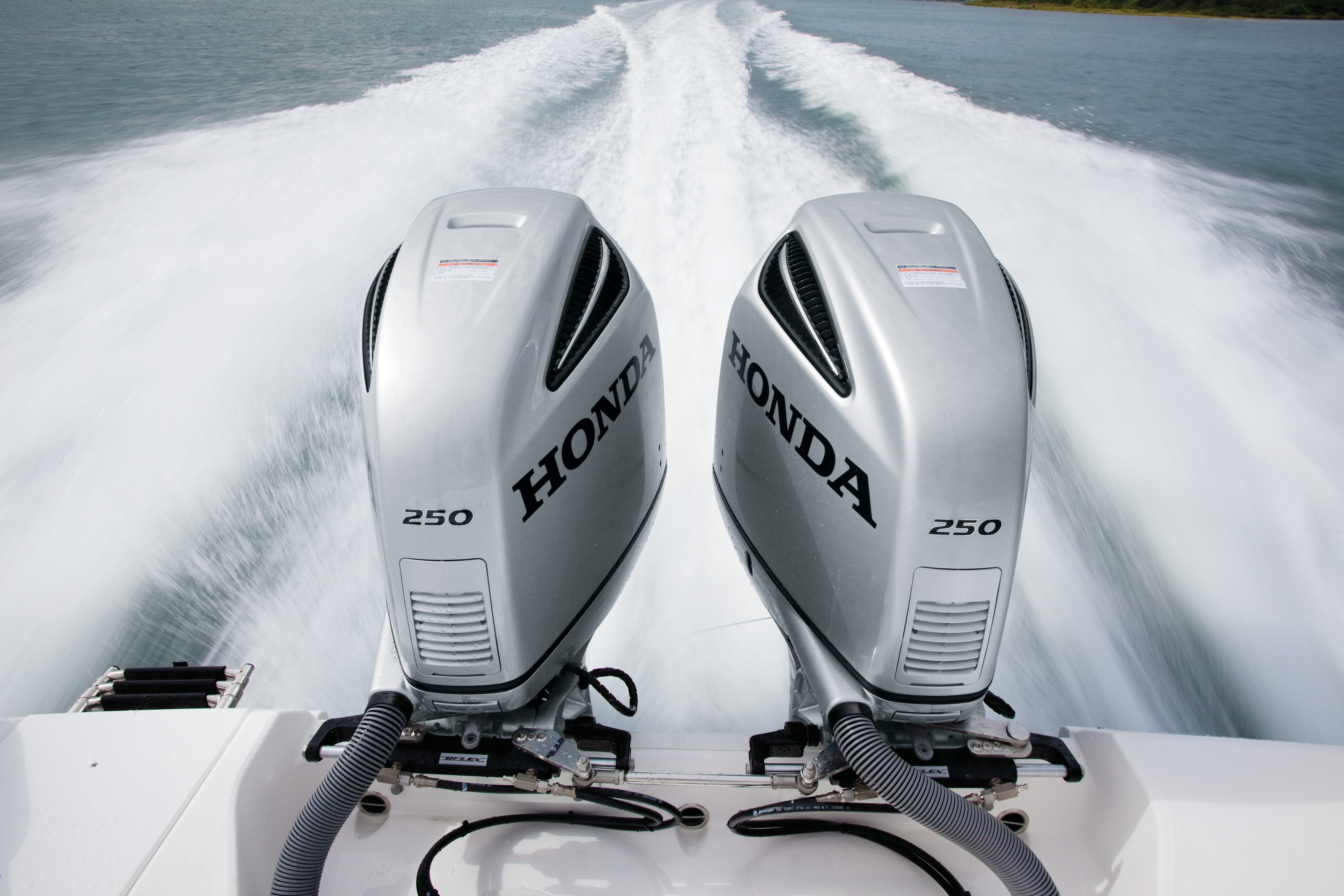 outboards profile redesigned honda news outboard boating debuts marine industry left